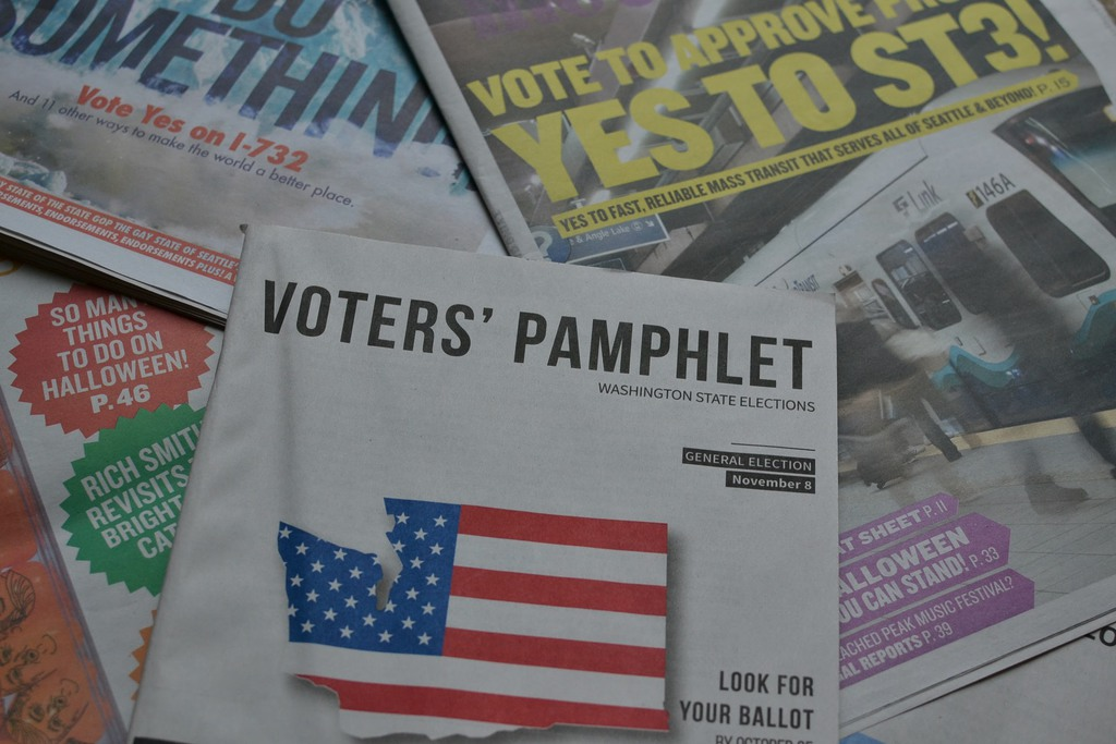 Voter's Pamphlet and newspapers